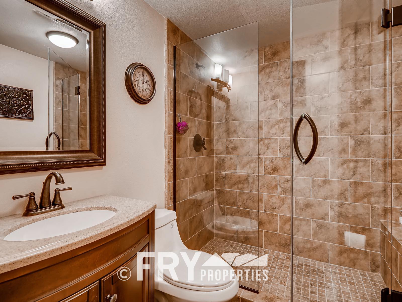 6305 W 6th Ave Unit A6-print-023-3-Lower Level Bathroom-3600x2400-300dpi