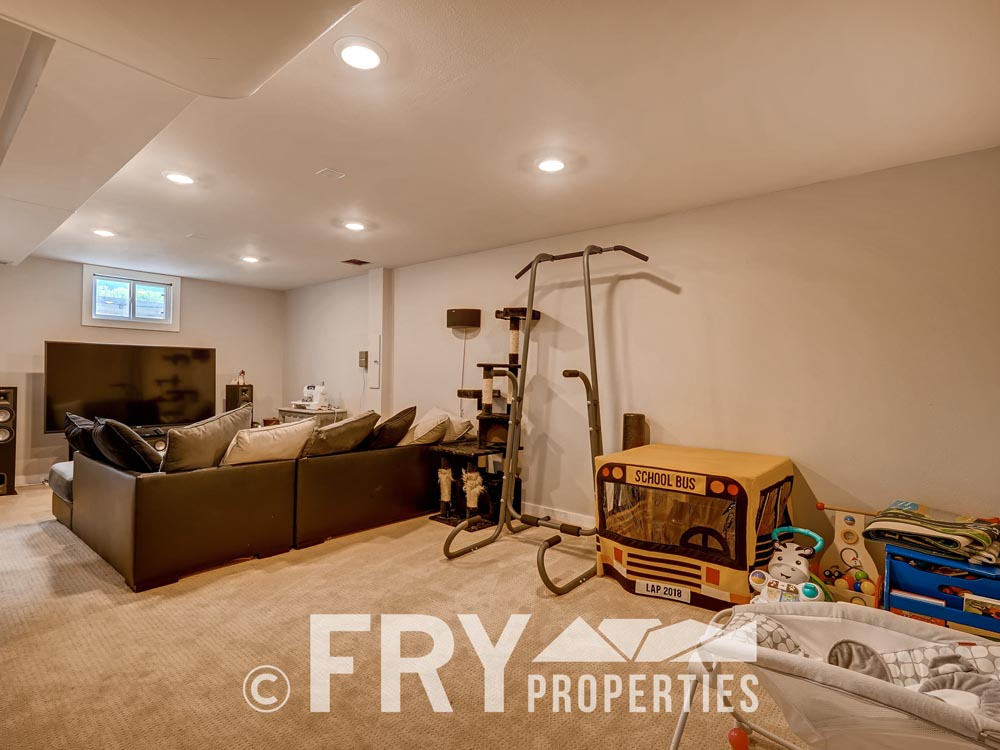 7074 Newland Street Arvada CO-print-018-18-Lower Level Family Room-3600x2400-300dpi